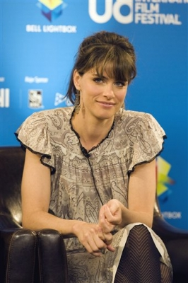 Amanda Peet listens to a question at the news conference for the film 'What doesn't kill you' at the Toronto Film Festival