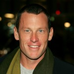 Champion cyclist Lance Armstrong smiles for the cameras at the &#8216;We Are Marshall&#8217; premiere 