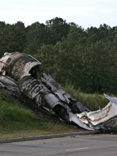 The wreckage of a Learjet that was carrying Travis Barker, DJ AM and four others