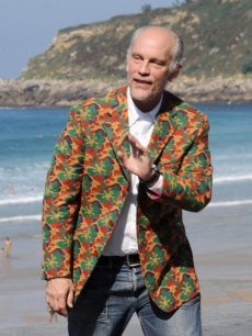 The colorful John Malkovich waves hello from the San Sebastian Film Festival