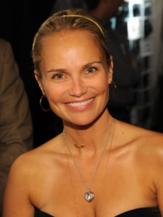 Kristin Chenoweth trying on a beautiful diamond necklace from Corsage by D'Annunzio.