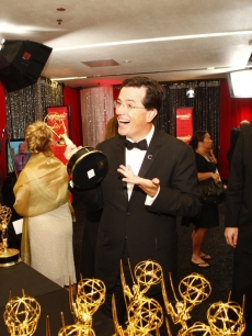 Stephen Colbert picks up his Emmy hardware backstage