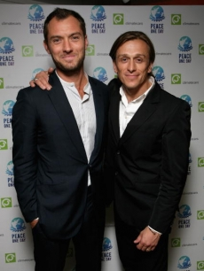 Jude Law and founder of Peace One Day Jeremy Gilley pose in London, 2008