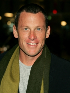 Champion cyclist Lance Armstrong smiles for the cameras at the 'We Are Marshall' premiere