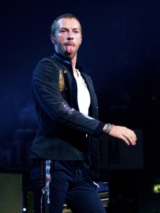Chris Martin of Coldplay performs at the DatchForum