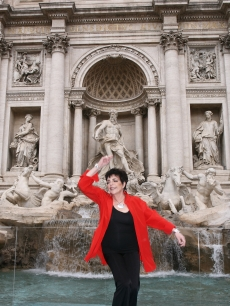 Liza Minnelli throws a coin into the Trevi Fountain as she presents her Live Tour