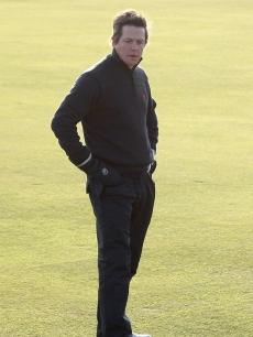 Hugh Grant looks for his ball at the Alfred Dunhill Links Championship in Scotland