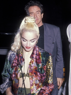 Then-couple Madonna and Warren Beatty head to a Blonde Ambition tour party, June 25, 1990 