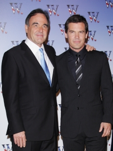 Oliver Stone and Josh Brolin pose at the Paris premiere of 'W,' Oct. 21, 2008