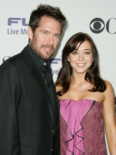 Alyson Hannigan and her husband, actor Alexis Denisof attend CBS Comedies' season premiere party at Area in West Hollywood