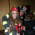 Mariah Carey and Nick Cannon as firefighters at a Halloween party at Marquee