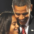 Barack Obama hugs his oldest daughter Malia following his victory