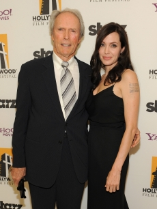 Clint Eastwood and Angelina Jolie pose backstage at the 12th Annual Hollywood Film Festival Awards Gala at the Beverly Hilton Hotel