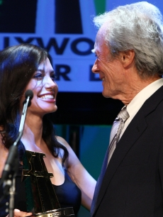 Angelina Jolie presents the Director of the Year award to Clint Eastwood onstage during the Hollywood Film Festival's Gala Ceremony