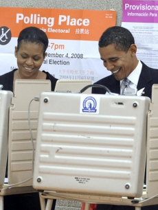 Michelle and Barack Obama cast their votes on Election Day in Chicago, Ill.