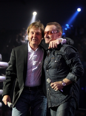 Paul McCartney and Bono hug on stage at the MTV Europe Music Awards in Liverpool, England