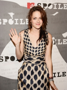 Kristen Stewart waves at a 'Twilight' sneak preview in Beverly Hills
