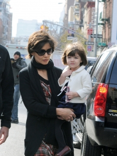 Katie Holmes walks with her daugther Suri in midtown Manhattan