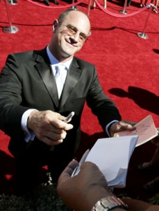 Christopher Meloni signs an autograph