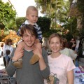 Daniel Giersch, Kelly Rutherford and their son Hermes pose during The Easter Beagle Presents Canine Couture at Palm Beach Fashion Week