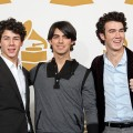 Nick Jonas, Joe Jonas, and Kevin Jonas of The Jonas Brothers pose in the press room during the Grammy Nominations concert