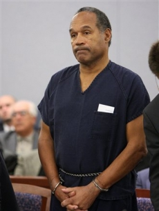 O.J. Simpson stands during his sentencing in Las Vegas (Dec. 5, 2008)