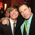 Zac Efron and John Travolta share an embrace at a &#8216;Hairspray&#8217; afterparty, 2007