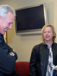 David Spade chats with a Phoenix police officer
