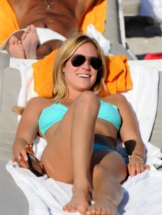 Kristin Cavallari soaks up some sun on South Beach in Miami following the New Year's celebrations
