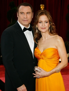John Travolta and wife Kelly Preston arrive at the Academy Awards in February 2008