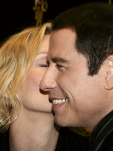 John Travolta gets a kiss from Uma Thurman at the 'Be Cool' UK premiere, March 2005