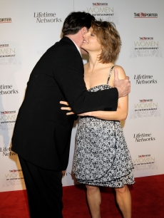 John Travolta and Jodie Foster share an embrace on the red carpet in LA, 2007