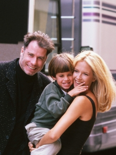 "John Travolta & Kelly Preston with son Jett Travolta, while she films ""Addicted to Love"" in 1997"