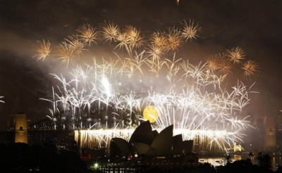 Fireworks explode over the Sydney Harbour Bridge and the Opera House during the New Year's celebrations on Sydney Harbour in Sydney, Australia