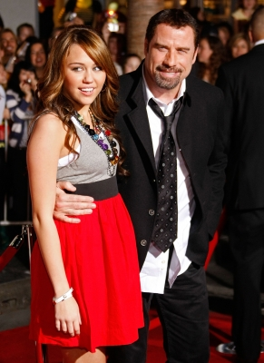 Miley Cyrus and John Travolta at the 'Bolt' premiere, 2008