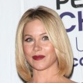 Christina Applegate poses with the award for Favorite Female TV Star in the press room at the 35th Annual People's Choice Awards