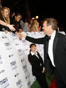 Hugh Laurie from &#8216;House&#8217; shakes hands with the fans as he heads into the People&#8217;s Choice Awards