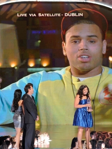 Jordin Sparks and Chris Brown (via satellite) accept the People's Choice Award for Combined Forces