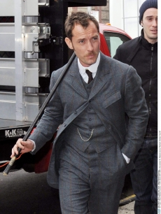 Jude Law films a scene as Dr. Watson for 'Sherlock Holmes' in New York