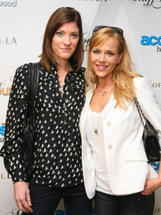 'Dexter' co-stars Jennifer Carpenter and Julie Benz pose at Access' Stuff You Must lounge