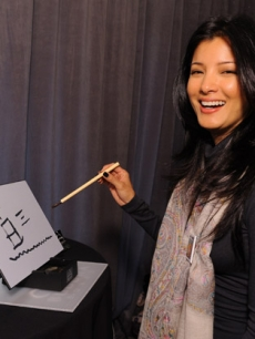 Kelly Hu draws on Buddha Board Inc.'s Buddha Board at Access' Stuff You Must lounge