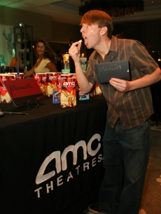 Jack McBrayer enjoys the popcorn and an AMC Entertainment signature movie pass at Access' Stuff You Must lounge
