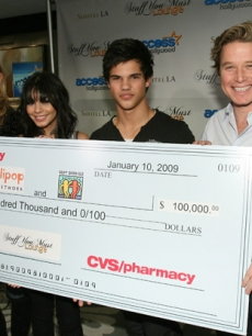 Access' Nancy O'Dell and Billy Bush accept CVS/Pharmacy's donation to the Best Buddies and Lollipop Theater Network charities with Vanessa Hudgens and Taylor Lautner