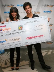 Vanessa Hudgens and Taylor Lautner present the CVS:Pharmacy donation to the Lollipop Theater Network and Best Buddies at Access' Stuff You Must lounge