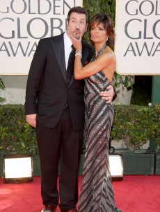 Joey Fatone and Lisa Rinna send kisses to the fans at the 66th Annual Golden Globe Awards