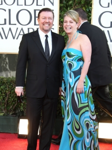 Ricky Gervais and partner Jane Fallon show their pearly whites on the Golden Globes red carpet