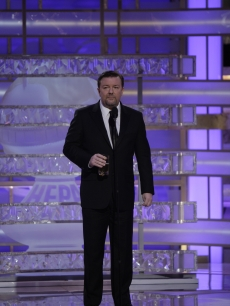 Ricky Gervais holds a drinkas he gives a memorable Golden Globes presentation