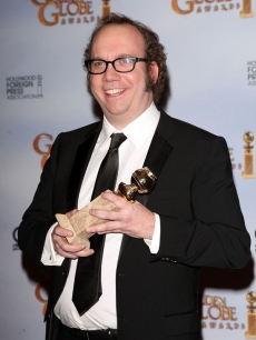 Paul Giamatti proudly shows off his Golden Globe for Best Actor in a TV Miniseries for 'John Adams'