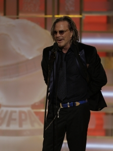 Mickey Rourke takes to the stage after winning his Golden Globe