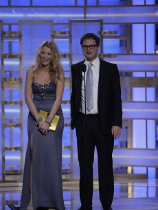 Blake Lively and Rainn Wilson share a laugh on stage at the Globes